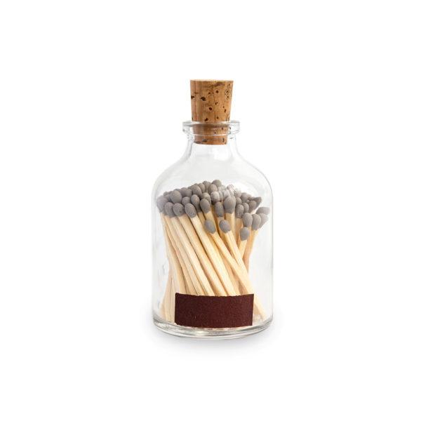 Tändstickor med grå topp i en glasburk med kork